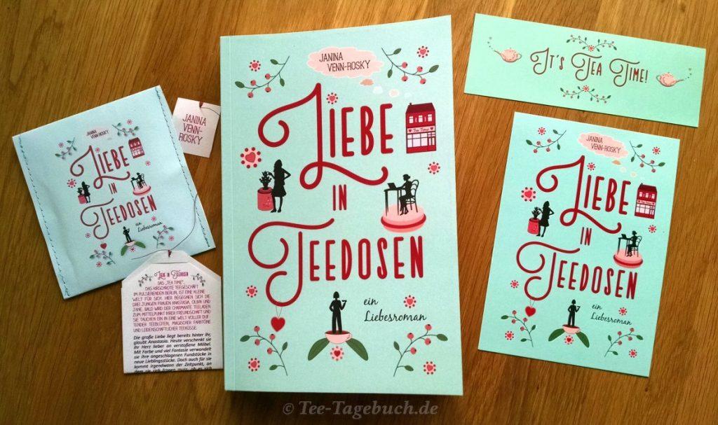 Buch, Postkarte, Lesezeichen und Teebeutel-Flyer mit zugehöriger Tüte