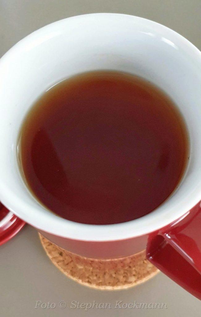 Berliner Kaffeerösterei - Teetasse mit Tee